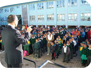 Dr Gary Paul addresses staff and learners during assembly at Greenville Primary School.